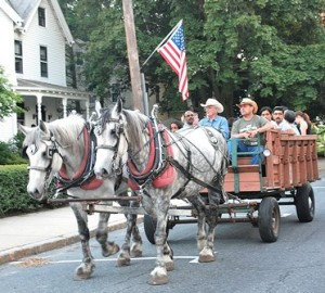 Guests take a horse-drawn hayride around the neighborhood.