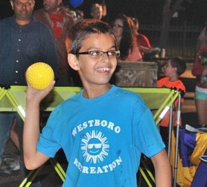 Siddharth Narayan, 9, pitches toward the dunk tank sponsored by the Westborough Lions Club.