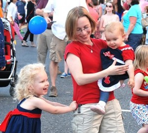 Michele dances with her daughters Summer, 3, and Holland, 1.