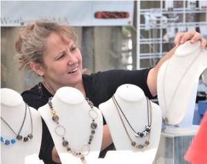 Holly Kenny of Elsie Kaye Glassworks displays handmade glass beads.