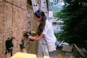 A member of Appalachia Service Project (ASP): Westborough works on a home in Chapmanville, W.V., during last year's trip. (Photos/submitted)
