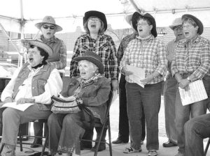 """Singing the Broadway tune """"Oklahoma"""" at the 2015 Arts in Common are members of the Southborough Senior Songsters, directed by Jim and Linda Duncan of Westborough. File photo/Ed Karvoski Jr."""
