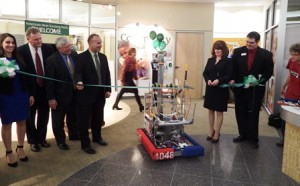 A robot built by the Westborough High School Robotics Team helps to cut the ribbon at the grand opening of the Berkshire Bank's new Westborough branch.  Photo/Bonnie Adams