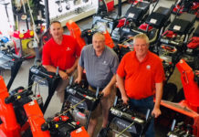 (l to r) Salesmen at Boston Lawnmower Company Rick Simonovitch, Garrett Baker and Peter Fenlason, are shown with some of the Ariens Snow Thrower lineup.