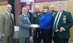 (front, l to r): Owen Russell, Central One Federal Credit Union, Auburn branch; David Kaiser, Central One,  Westborough  branch manager; Alma DeManche, Westborough Senior Center Director, and Denny Drewry, member, Westborough Board of Selectmen and Quarter Master, Westborough Veterans of Foreign Wars Post 9013  (back, l to r): Zachary Daniels, Central One marketing manager, and VFW members Armand Powers and Ron Perry  Photo/submitted