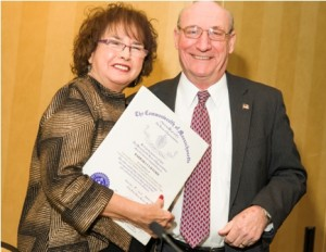 Barbara Clifford, president of Corridor Nine, accepts a certificate of appreciation from state Rep. George Peterson Jr., R-Grafton.  Photo/courtesy Ron Bouley Photography