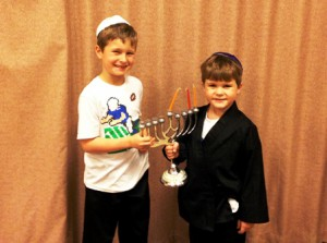 Ben (left) and Alex Friedberg with their menorah