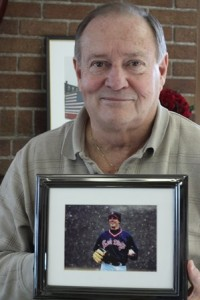 Westborough Recreation Director Frank DeSiata displays a photo of Greg Montalbano at his office on Jan. 8. DeSiata, who is being honored with the Greg Montalbano Award, said he may retire this spring. Photo/John Swinconeck