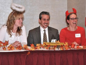 Armstrong Parent Group teammates (l to r) Amy Fitzgibbon, Adam Halem and Heather Kane are amused by a trivia question.