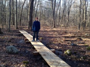 John O'Connell stands on a new section of trail created for his project.