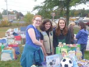 (l to r) Emily Reed-Edwards, Rachel Kaufman, and Heidi Mannarino of Westborough Girl Scout Troup 30555 work at their yard sale fundraiser. (Photo/Bryna Dudek)