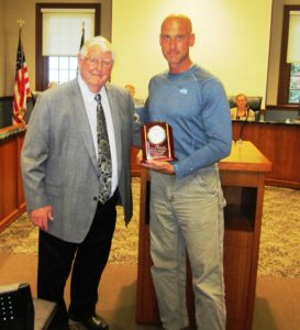 Jim Harvey, CEO and treasurer, E.L Harveys & Sons (l) receives the town's Stormwater Management and Quality Water Award from Derek Saari, the town's conservation officer.