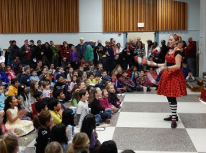 Jenny the Juggler performs in front of a captivated audience at the Hastings Winter Festival.