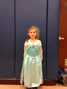 """Grace, dressed as Elsa from the movie """"Frozen,"""" poses for a picture."""