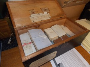 Boxes containing bundles of historical documents, like this one, were found in Westborough's Town Hall vault.