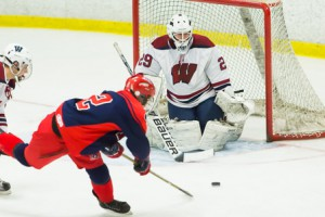 Westborough goalie Jared Ward blocks a shot from North Middlesex Devon Blanchard.