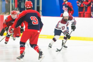 Westborough's Trey Howes looks to maneuver the puck around North Middlesex defenders.