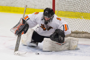 Marlborough goalie Brian Powell dives on a loose puck in front of the net.