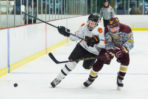 Marlborough's Luke Goulet and Algonquin's Thomas Ackil fight for a loose puck.