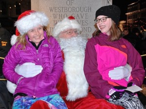 Samantha Lasch and Lola Hudnall, both 9, share a laugh with Santa.
