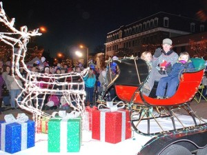 A float sponsored by Uhlman's Ice Cream rides by the rotary.