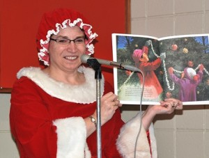 Mrs. Claus reads a holiday story at the library.