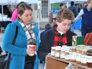 Sabrina Resende and her son, Kyle, 10, browse items at the Harvey's Farm & Garden Center booth.