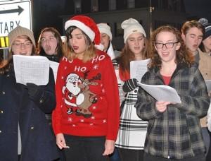 Members of the Westborough High School Chorus sing carols.