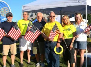 Ready to distribute American flags are Rotary Club of Westborough members: (l to r) Treasurer Paul Reilly, President Elect Elliott Rittenberg, Bill Witherell, Vice President Gary Kelley, Reina Rago and President Betsy Moquin. Photos/Ed Karvoski Jr.