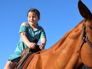 Evelyn Surber rides around Bay State Green on a pony. Photos/Ed Karvoski Jr.