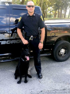 Officer Caleb Polseno with Lukas Photo/submitted