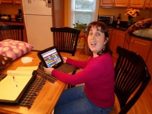 Kate Atchue with the DynaVox machine that helps her speak. (Photos/submitted)