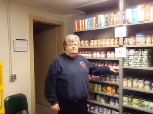 Phil Kittredge in the Westborough Food Pantry. (Photo/Bonnie Adams)