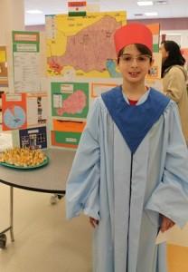 Corey Vandoren, 11, next to his project about Niger.