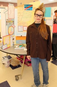 Becky Bartlett, 12, near her project on The Democratic Republic of the Congo.