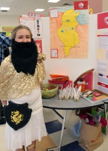 Nicole Alcock, 11, stands by her project about Tunisia.