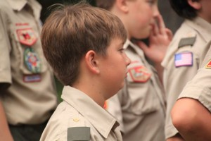 Boy Scout Liam Johnson listens to the guest speakers.