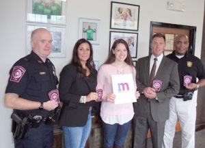 (l to r) Westborough Police Department Lt. Glenn McLeod; One Mission Cofounder and President Ashley Haseotes; One Mission Administrative and Marketing Coordinator Paige Crane; WPD Chief of Police Jeffrey Lourie; and WPD Detective Michael Daniels at the One Mission office. Photo/Christine Galeone