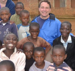 Pastor John Taylor poses with children on a church mission trip to Rwanda and the Congo. (Photo/submitted)