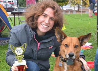 Alyssa DiGiovanni holds the Best Ears trophy won by her dog Rudy. Photos/Ed Karvoski Jr.
