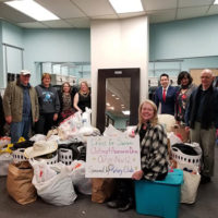 Members of the Rotary Club of Westborough with donations they collected for Dress for Success. Photo/submitted