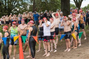 Swimmers wait their turn to enter Lake Chauncy for their 0.25 mile swim.