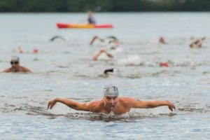 Michael O'Brien of Rollinsford, N.H. finishes up his swim with a few butterfly strokes.
