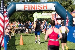 Runners approach the finish line at the Rotary Triathlon.