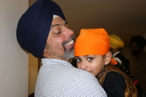 9.Young child and father at New England Sikh Study Circle in Milford