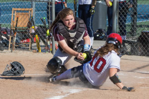 Algonquin's Brianna Calder tags out Westborough's Maia Morgado as she attempts to score