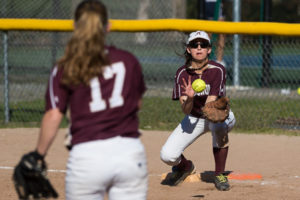 Algonquin's Amanda Pageau receives a throw from pitcher Gaby Kennedy