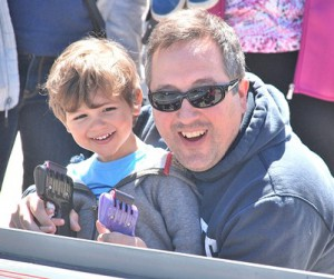 Michael Mihopoulos, 2, and his dad Christos compete in a slot car race.