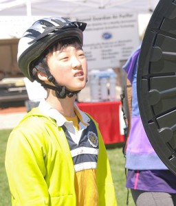 """Daniel Zeng, 10, awaits the wheel landing on """"hackey sack,"""" the prize he won from Marlborough Savings Bank at the Discover Westborough Expo."""