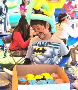 Making the rounds at the Kids Carnival, Kapish Kaza, 8, checks out the prizes of the cupcake walk.